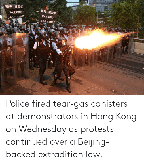 Beijing, Police, and Hong Kong: 警告 催波煙  警告 催淚煙  WARNING  WARNING  SEAR SMOXE  TEAR SMOKE Police fired tear-gas canisters at demonstrators in Hong Kong on Wednesday as protests continued over a Beijing-backed extradition law.