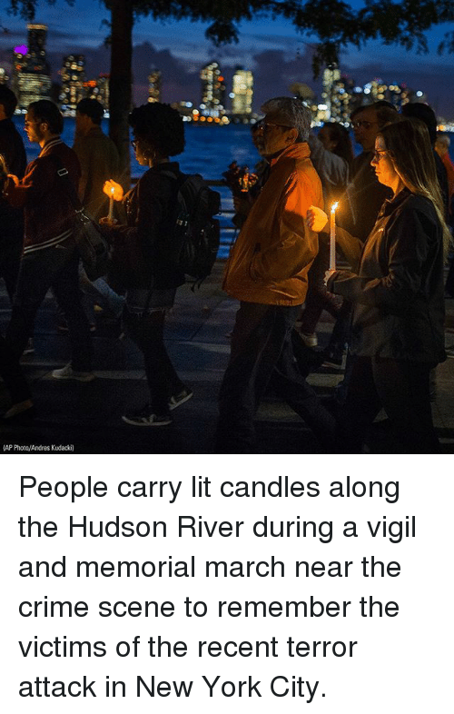 Andres: 13 1  AP Photo/Andres Kudacki) People carry lit candles along the Hudson River during a vigil and memorial march near the crime scene to remember the victims of the recent terror attack in New York City.