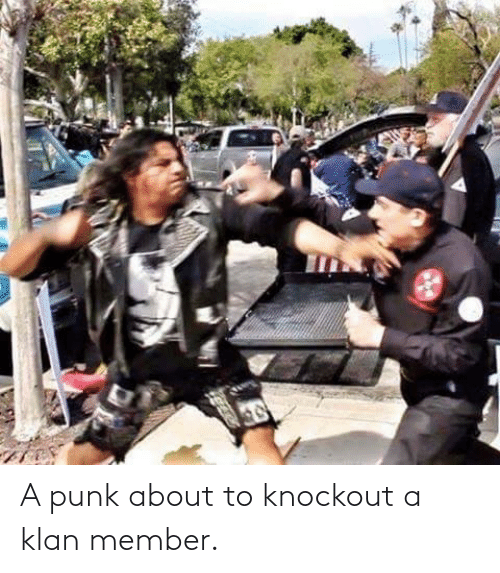 About To: A punk about to knockout a klan member.