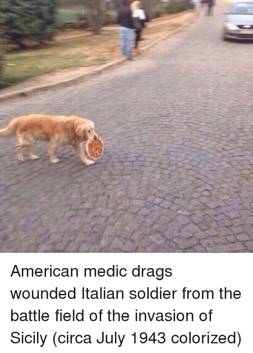Medic: American medic drags wounded Italian soldier from the battle field of the invasion of Sicily (circa July 1943 colorized)