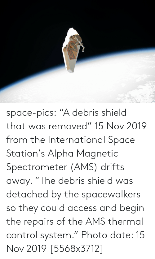 "the international: AMS-02 space-pics:  ""A debris shield that was removed"" 15 Nov 2019 from the International Space Station's Alpha Magnetic Spectrometer (AMS) drifts away. ""The debris shield was detached by the spacewalkers so they could access and begin the repairs of the AMS thermal control system."" Photo date: 15 Nov 2019 [5568x3712]"