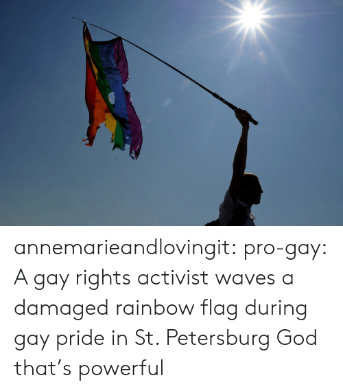 God, Tumblr, and Waves: annemarieandlovingit: pro-gay: A gay rights activist waves a damaged rainbow flag during gay pride in St. Petersburg  God that's powerful