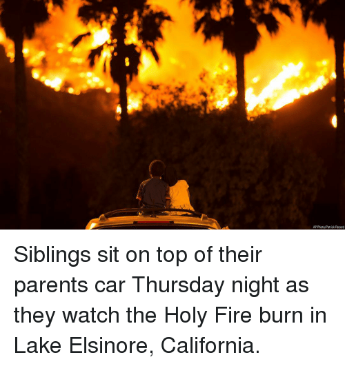 Fire, Memes, and Parents: AP Photo/Patrick Record Siblings sit on top of their parents car Thursday night as they watch the Holy Fire burn in Lake Elsinore, California.
