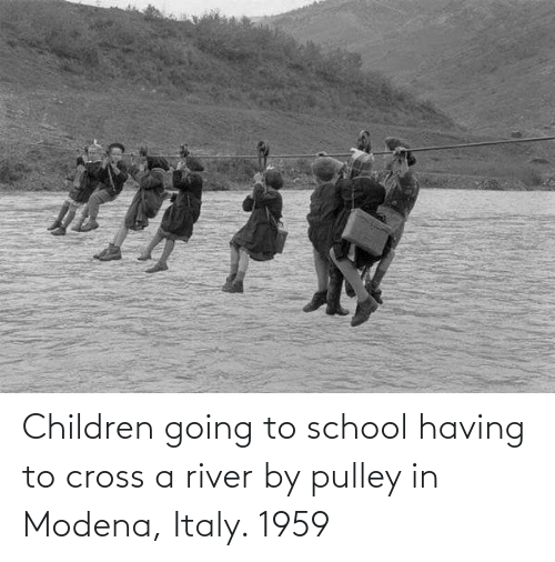 river: Children going to school having to cross a river by pulley in Modena, Italy. 1959