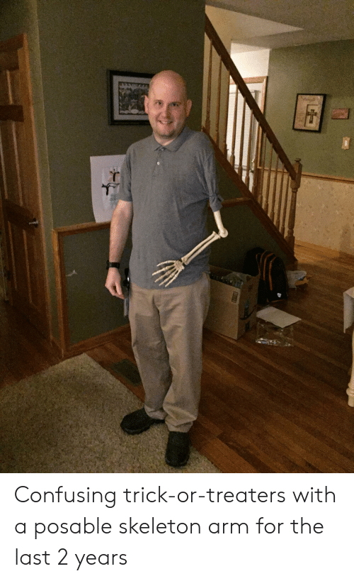 arm: Confusing trick-or-treaters with a posable skeleton arm for the last 2 years