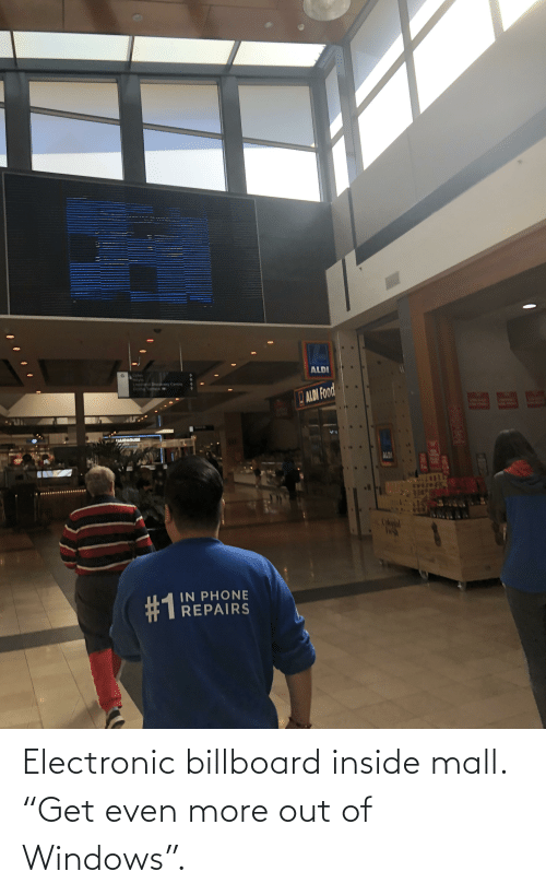 """Billboard: Electronic billboard inside mall. """"Get even more out of Windows""""."""