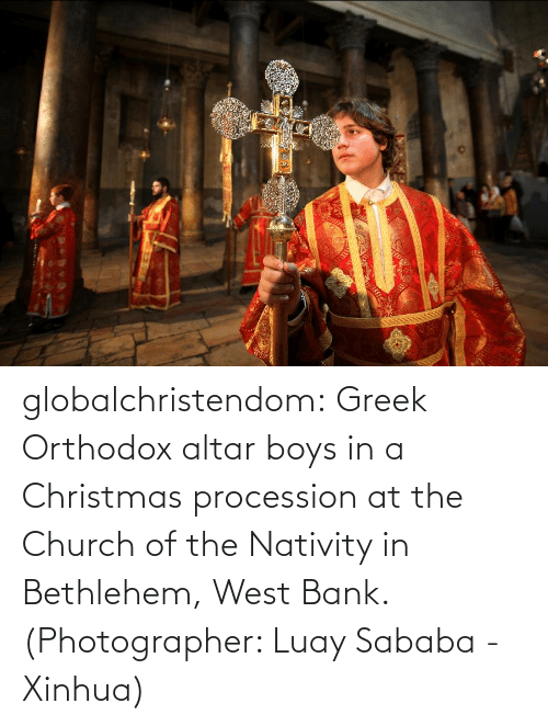 Bank: globalchristendom: Greek Orthodox altar boys in a Christmas procession at the Church of the Nativity in Bethlehem, West Bank. (Photographer: Luay Sababa - Xinhua)