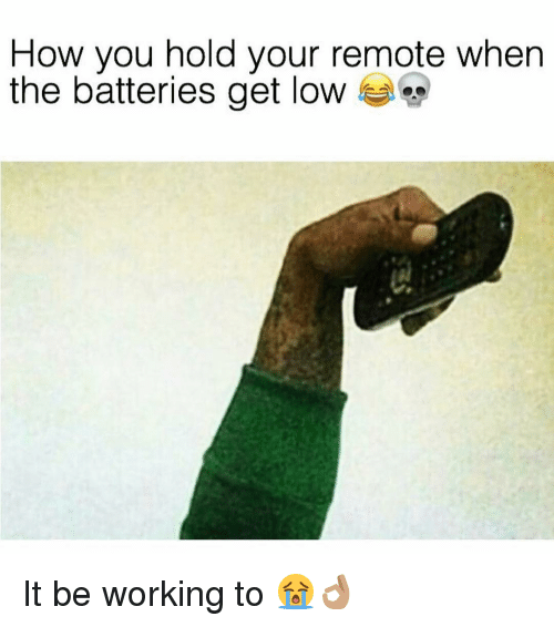 get low: How you hold your remote when  the batteries get low It be working to 😭👌🏽