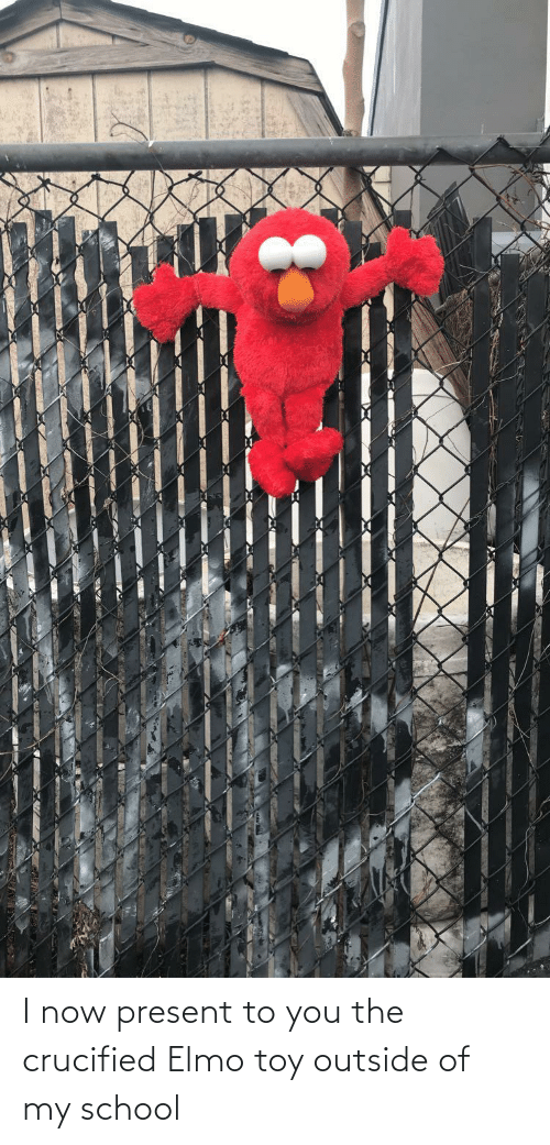 Elmo: I now present to you the crucified Elmo toy outside of my school