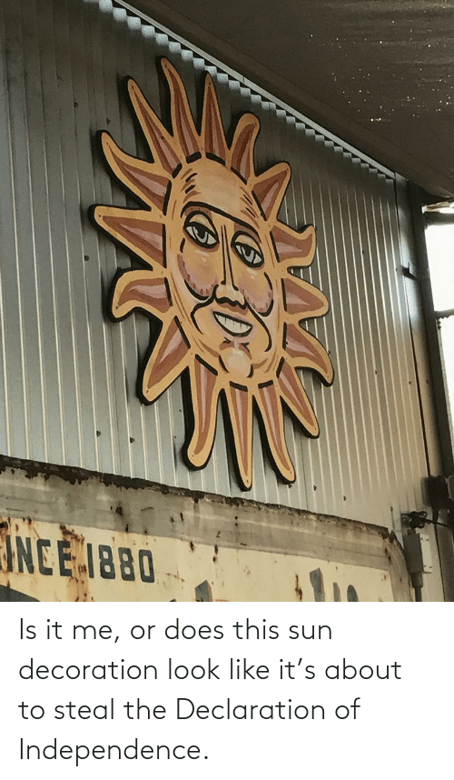 Is It: Is it me, or does this sun decoration look like it's about to steal the Declaration of Independence.