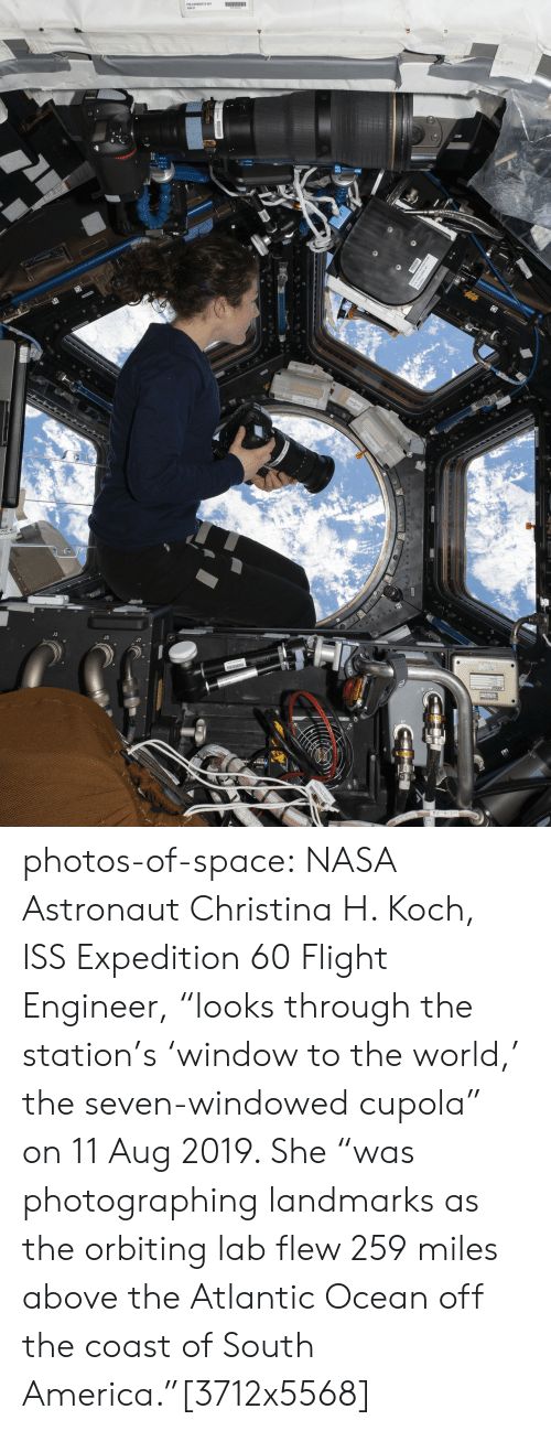 """Lab: le photos-of-space:  NASA Astronaut Christina H. Koch, ISS Expedition 60 Flight Engineer, """"looks through the station's 'window to the world,' the seven-windowed cupola"""" on 11 Aug 2019. She """"was photographing landmarks as the orbiting lab flew 259 miles above the Atlantic Ocean off the coast of South America.""""[3712x5568]"""