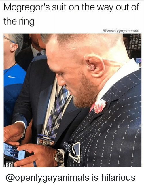 Of The Ring: Mcgregor's suit on the way out of  the ring  @openlygayanimals  nD @openlygayanimals is hilarious