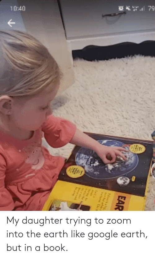 my daughter: My daughter trying to zoom into the earth like google earth, but in a book.