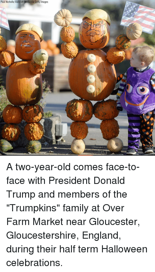 """Donald Trump, England, and Family: Paul Nicholls/ Barcroft Media via Getty Images A two-year-old comes face-to-face with President Donald Trump and members of the """"Trumpkins"""" family at Over Farm Market near Gloucester, Gloucestershire, England, during their half term Halloween celebrations."""