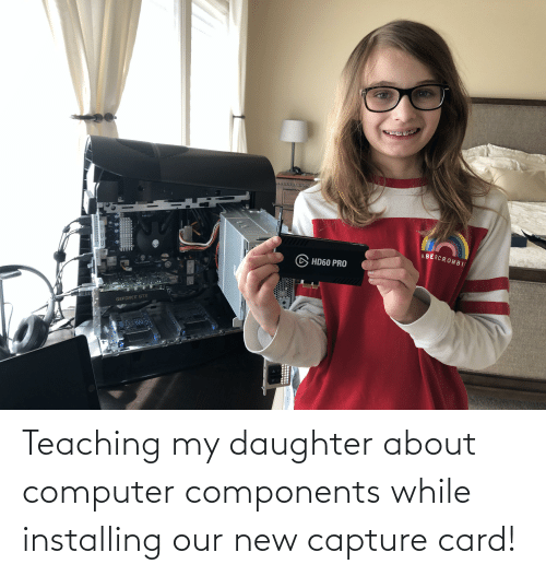 my daughter: Teaching my daughter about computer components while installing our new capture card!