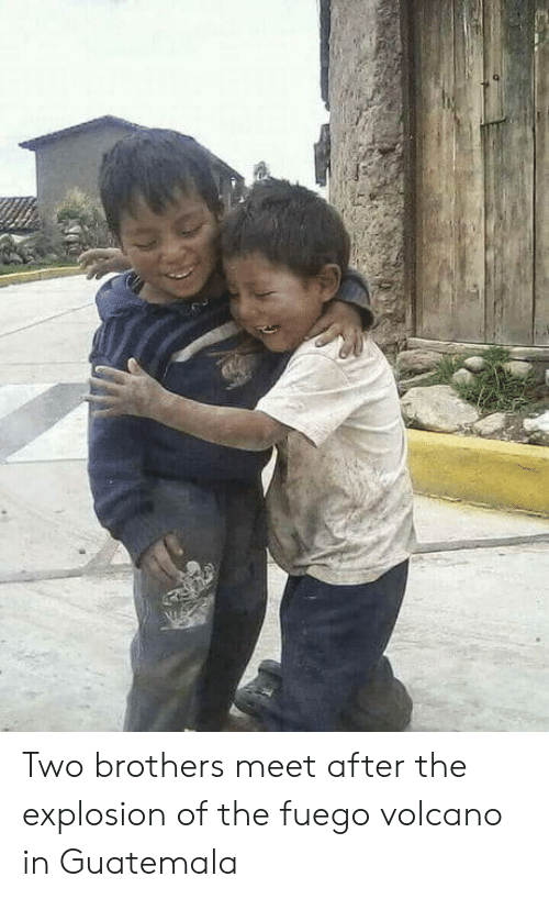 Volcano, Guatemala, and Brothers: Two brothers meet after the explosion of the fuego volcano in Guatemala