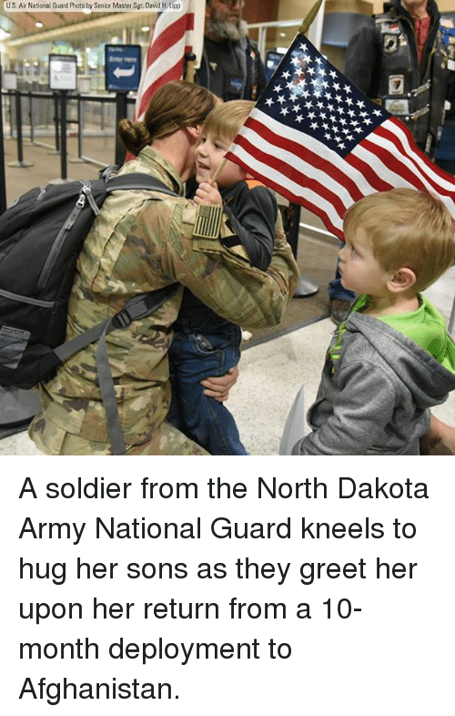 national guard: U.S. Air National Guard Photo by Senior Master Sgt. David H.Lipp A soldier from the North Dakota Army National Guard kneels to hug her sons as they greet her upon her return from a 10-month deployment to Afghanistan.