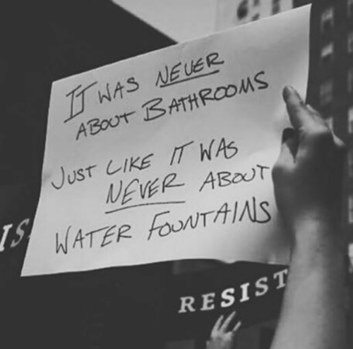 Resist: WAS NEUER  ABOUT BATHROOMS  JusT LIKE IT WAS  NEVER ABOUT  WATER FouNTAIS  RESIST